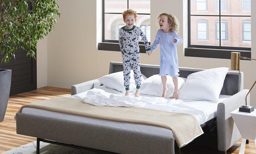 American Leather Harris Comfort Sleeper-kids jumping